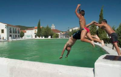 Residents swim to the town hall or to church