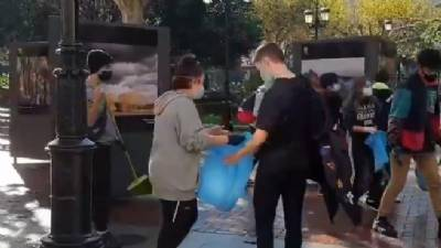 Teens decide to clean their streets after night riot and are praised by national president